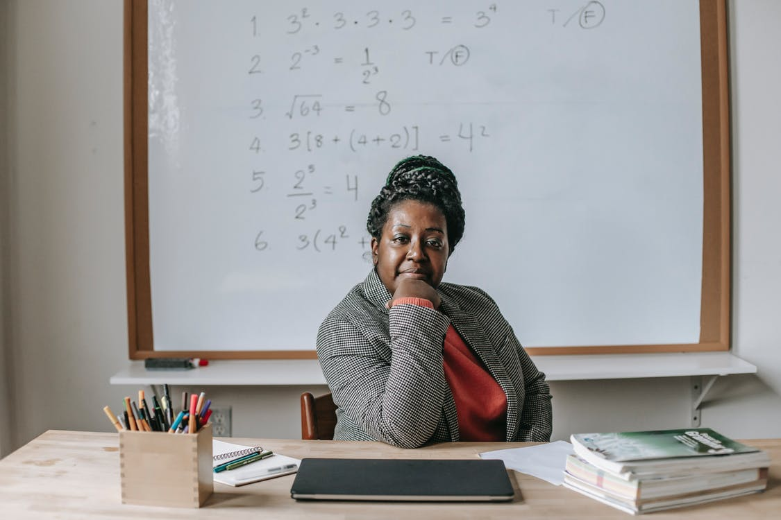 Confident black woman sitting in classroom